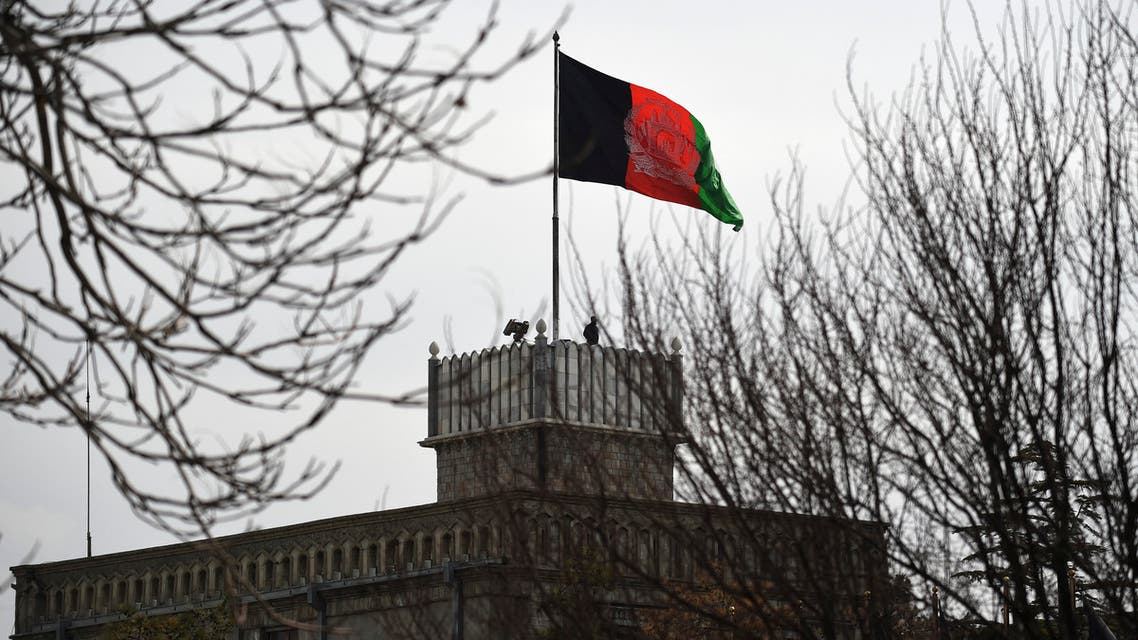 An Afghan security personnel keeps watch on a tower as the Afghan national flag flutters ahead of the start of Afghanistan President Ashraf Ghani's swearing-in inauguration ceremony, at the Presidential Palace in Kabul on March 9, 2020. (AFP)