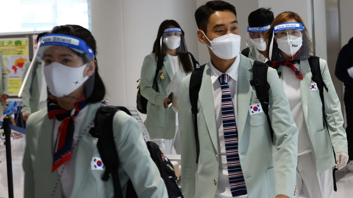South Korea team members wearing protective face masks and face shields arrive at Narita International Airport ahead of the Tokyo 2020 Olympic Games on July 19, 2021. (Reuters)