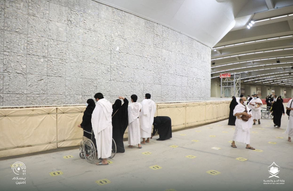 Pilgrims throw a stone at the giant wall, which represents the devil, in Mina, Saudi Arabia. (Twitter)