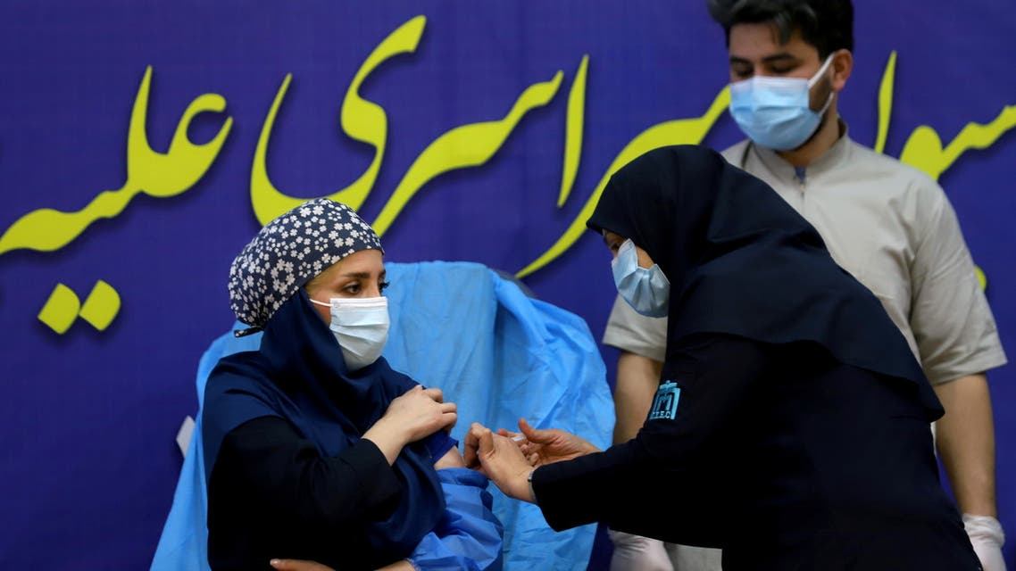 A member of the Imam Khomeini Hospital medical personnel receives a dose of Russia's Sputnik V vaccine against the coronavirus disease (COVID-19), in Tehran, Iran February 9, 2021. Majid Asgaripour/WANA (West Asia News Agency) via REUTERS ATTENTION EDITORS - THIS IMAGE HAS BEEN SUPPLIED BY A THIRD PARTY.