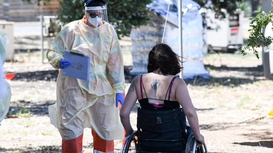 Medical staff talk to people at a walk in station at Parafield Airport in Adelaide during day one of total lockdown across the state to fight Covid-19 coronavirus on November 18, 2020. (File photo: AFP)