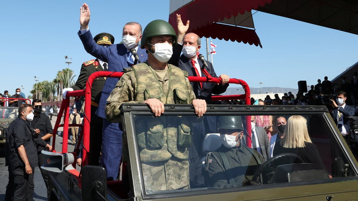Turkish President Tayyip Erdogan and Turkish Cypriot leader Ersin Tatar attend a military parade in Cyprus where there is a breakaway state recognized only by Turkey, July 20, 2021. (AFP)