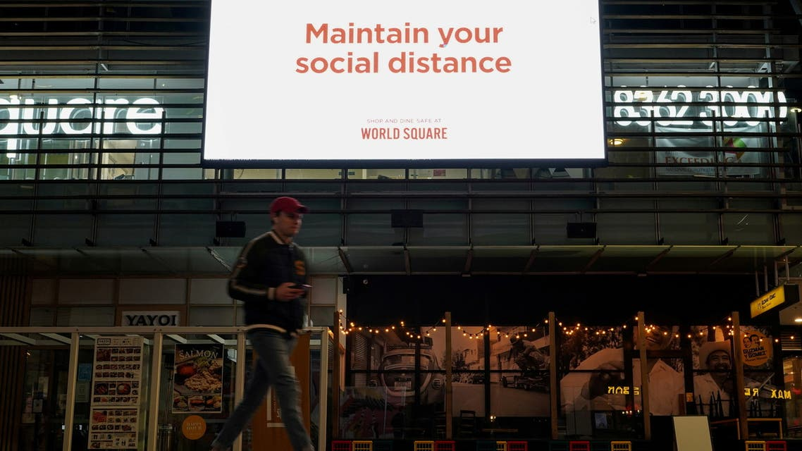 A man walks under a public health message about social distancing displayed at a shopping plaza in the city centre during a lockdown to curb the spread of a coronavirus disease (COVID-19) outbreak in Sydney, Australia, July 6, 2021. (File Photo: Reuters)