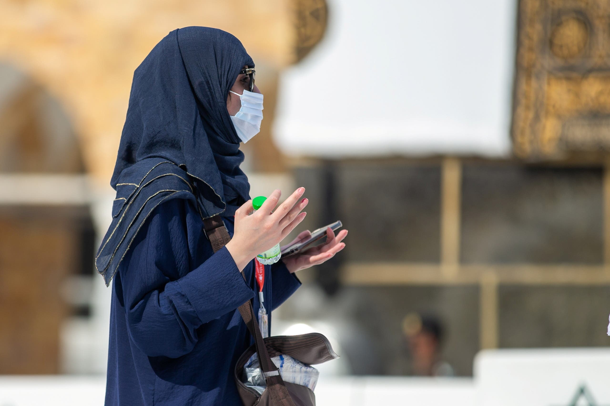 A female pilgrim gestures as she performs Tawaf around Kaaba at the Grand Mosque during the annual Haj pilgrimage, in the holy city of Mecca, Saudi Arabia, July 17, 2021. (Reuters)