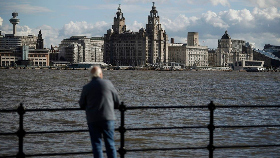 A man looks towards Liverpool's iconic waterfront across the River Mersey in Birkenhead , northern England. (File photo: Reuters)