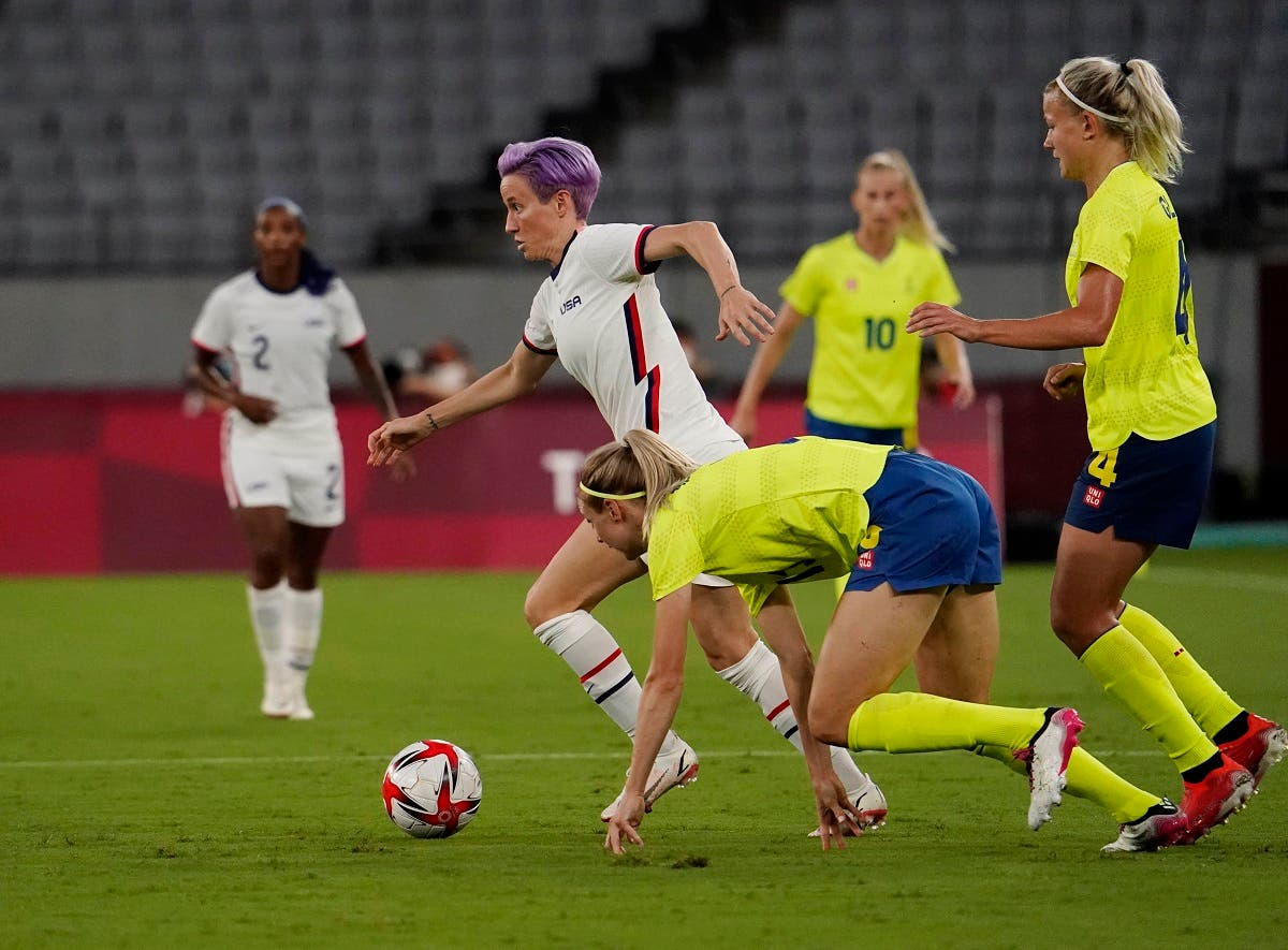 United States forward Megan Rapinoe (15) chases the ball against Sweden during the second half in Group G play during the Tokyo 2020 Olympic Summer Games at Tokyo Stadium. (Reuters)