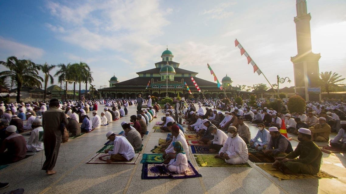 Indonesian Muslims offer Eid al-Adha prayers at a mosque amid a surge of coronavirus disease (COVID-19) cases in Banjarmasin, South Kalimantan province, Indonesia . (Reuters)