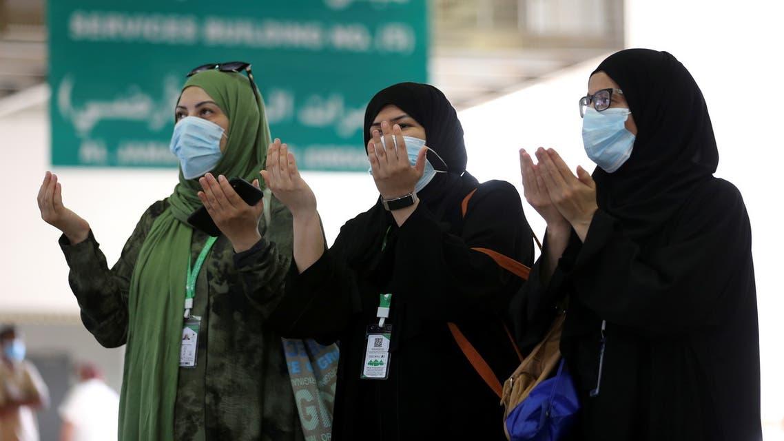 Muslim pilgrims pray after throwing stones at a pillar symbolising Satan during the annual Haj pilgrimage, amid the coronavirus disease (COVID-19) pandemic, in Mina, near the holy city of Mecca, Saudi Arabia, July 20, 2021. (Reuters)
