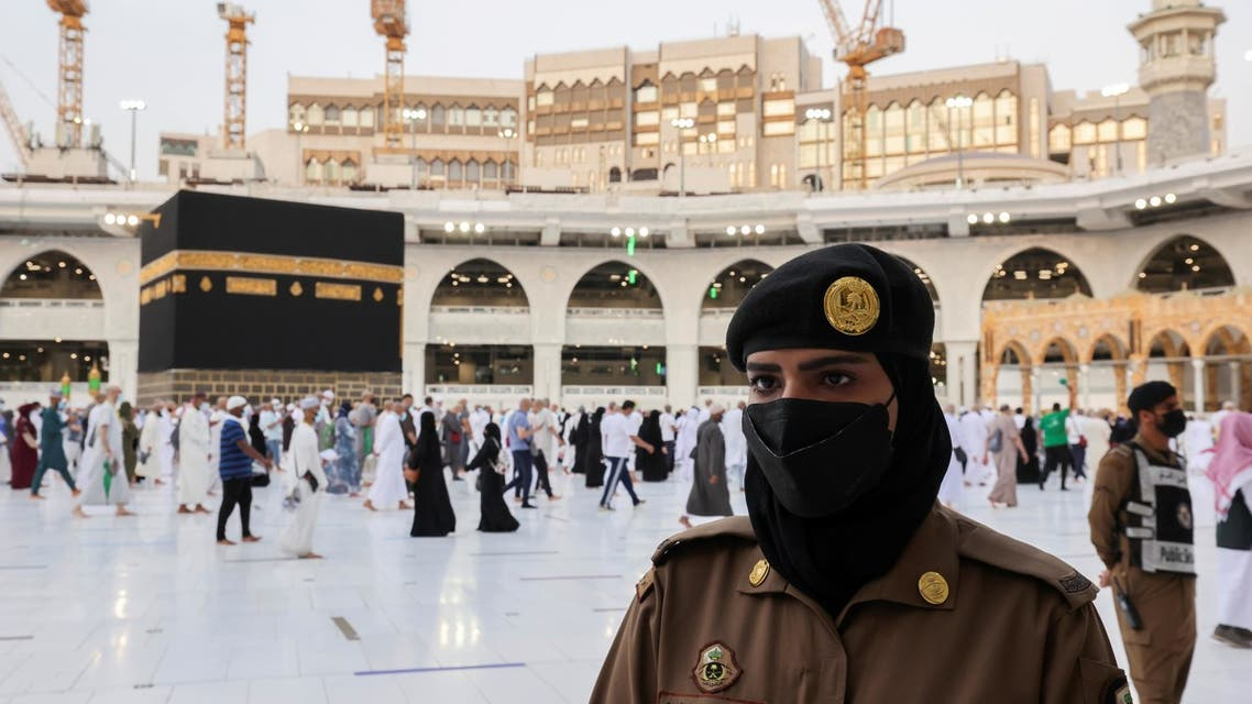 A Saudi police female officer stands guard as pilgrims perform final Tawaf during the annual Haj pilgrimage, in the holy city of Mecca, Saudi Arabia July 20, 2021. REUTERS/Ahmed Yosri
