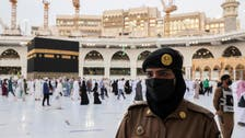 Saudi women stand guard during Hajj for the first time