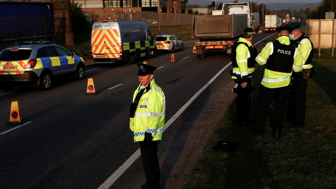 A police officer looks on during a joint operation by the Police Service of Northern Ireland (PSNI), Driver Vehicle Agency goods enforcement division and Her Majesty's Revenue and Customs (HMRC), at Belfast Port, Northern Ireland April 22, 2021. REUTERS/Jason Cairnduff