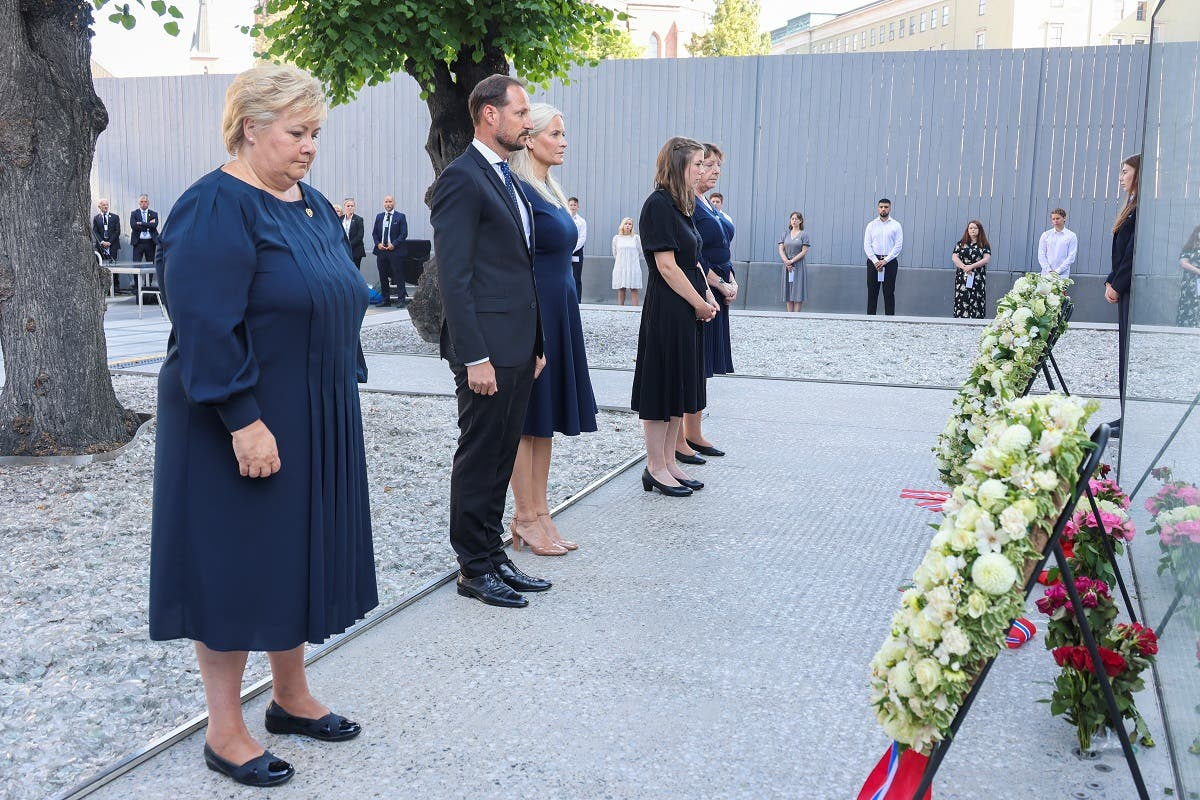 Norway's PM Erna Solberg, Crown Prince Haakon, Crown Princess Mette-Marit, Workers' Youth League (AUF) leader Astrid Hoem, and a support group leader Lisbeth Kristine Roeyneland attend a memorial service in the Government Quarter 10 years after the Oslo and Utoeya island bomb attack, in Oslo, Norway, on July 22, 2021. (Reuters)