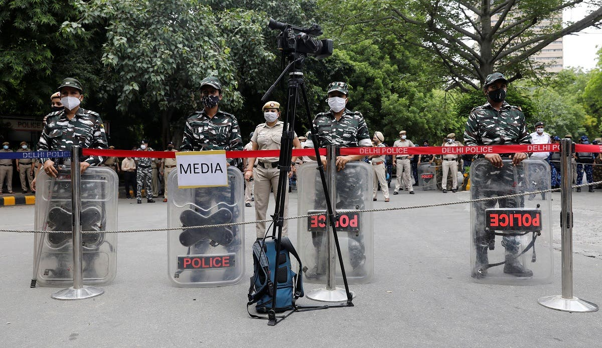 Security personnel stand guard at the site of a sit-in protest by farmers against the farm laws, near parliament house, in New Delhi, India, July 22, 2021. (Reuters)
