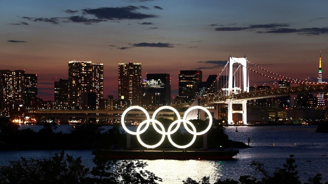 The Olympic Rings are seen in front of the skyline during sunset one night ahead of the official opening of the Tokyo 2020 Olympic Games in Tokyo, Japan, on July 22, 2021. (Reuters)