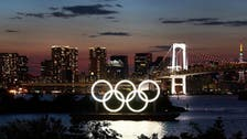 New COVID-19 cases near 2,000 in Tokyo a day before Olympics open