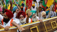 Angry Indian farmers gather near parliament seeking repeal of laws