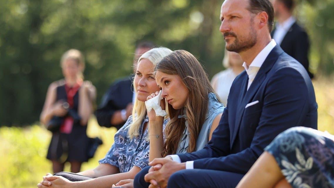 Norway's Crown Princess Mette-Marit, Princess Ingrid Alexandra and Crown Prince Haakon attend a memorial service as Norway marks 10 years since the Oslo and Utoeya island attacks, on Utoeya island, Norway, on July 22, 2021. (Reuters)