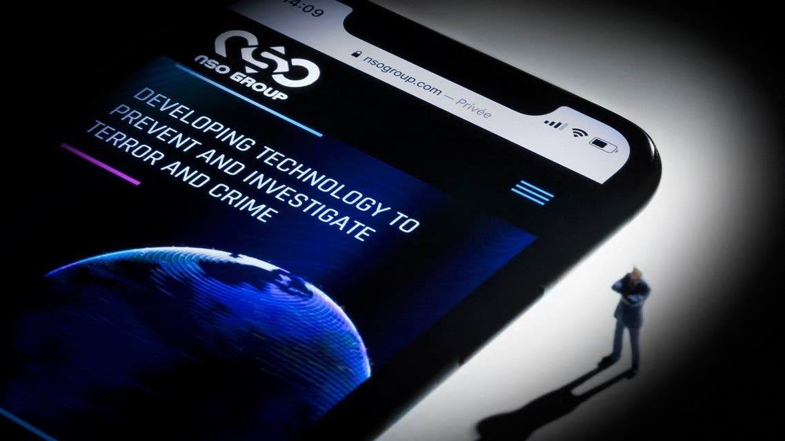 This studio photographic illustration shows a smartphone with the website of Israel's NSO Group which features 'Pegasus' spyware, on display in Paris on July 21, 2021. (AFP)