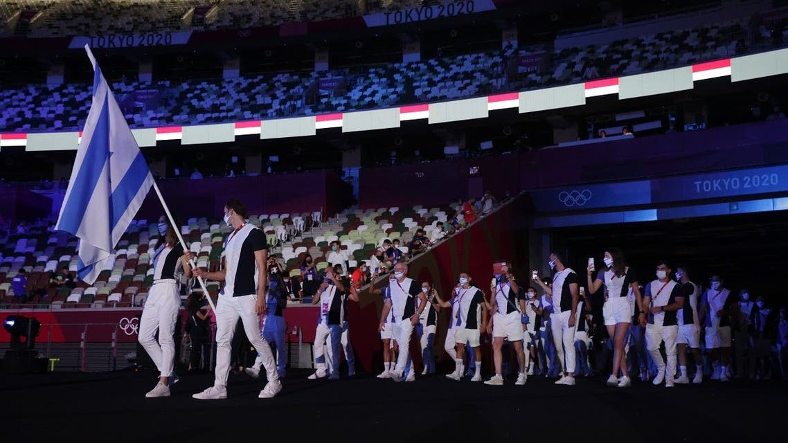 Flag bearers Yakov Toumarkin of Israel and Hanna Knyazyeva-Minenko of Israel lead their contingent during the athletes' parade at the opening ceremony  at the Olympic Stadium, Tokyo, Japan, on July 23, 2021. (Reuters)