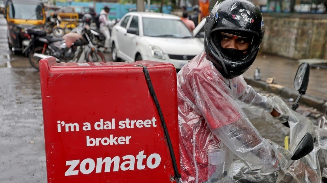 A delivery worker of Zomato, an Indian food-delivery startup, prepares to leave to pick up an order from a restaurant in Mumbai, India, July 13, 2021. (Reuters)
