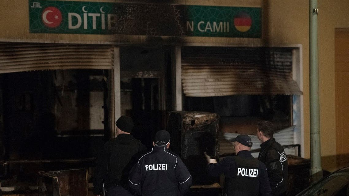 In this March 11, 2018 file photo, police stand in front of a mosque that was attacked overnight in Berlin. (AP)