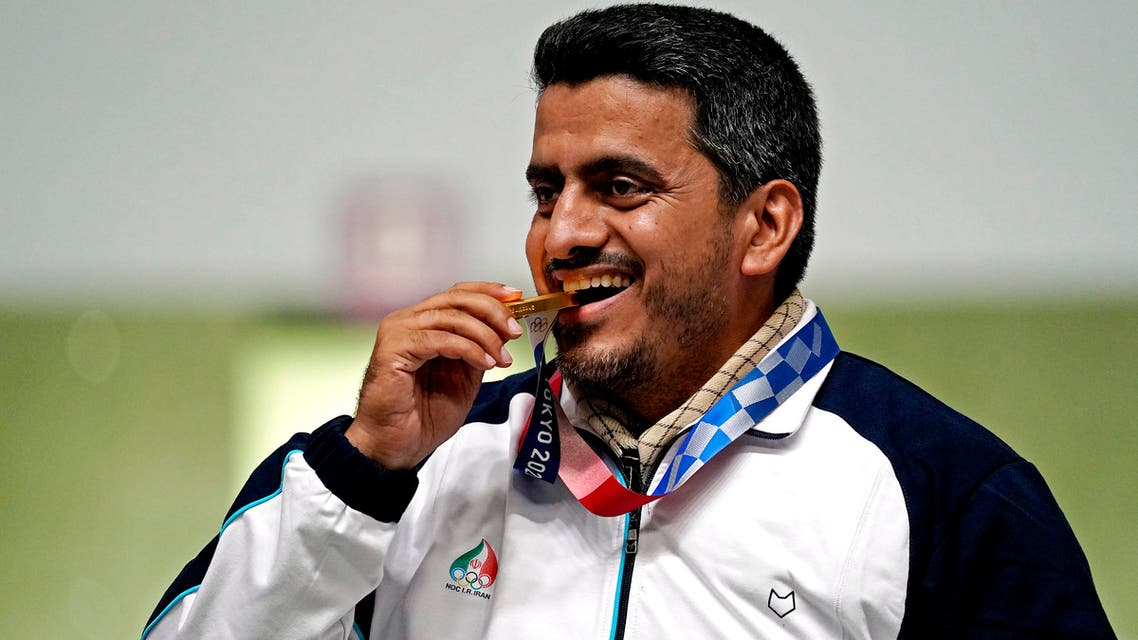 Javad Foroughi celebrates winning the gold medal in the 10m Air Pistol Men's Final during the Tokyo 2020 Olympic Summer Games at Asaka Shooting Range in Tokyo, Japan. (USA TODAY/Reuters)