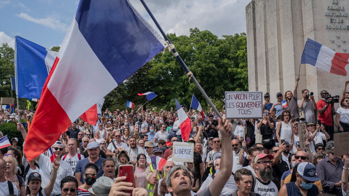 Thousands of protesters gather at Place Trocadero near the Eiffel Tower attend a demonstration in Paris, France, Saturday July 24, 2021, against the COVID-19 pass which grants vaccinated individuals greater ease of access to venues. (AP)