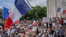 Far-right and others march against French COVID-19 rules