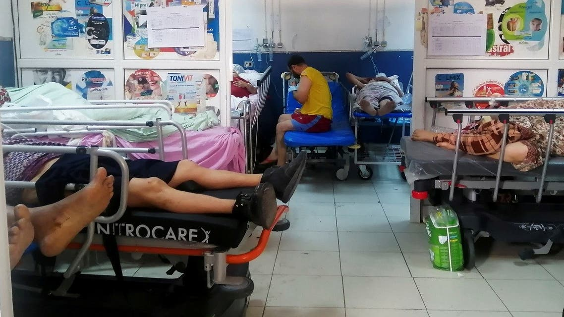 Patients suffering from the coronavirus disease (COVID-19) receive treatment at the emergency department of Charles Nicole Hospital in Tunis, Tunisia July 13, 2021. (Reuters/Jihed Abidellaoui)