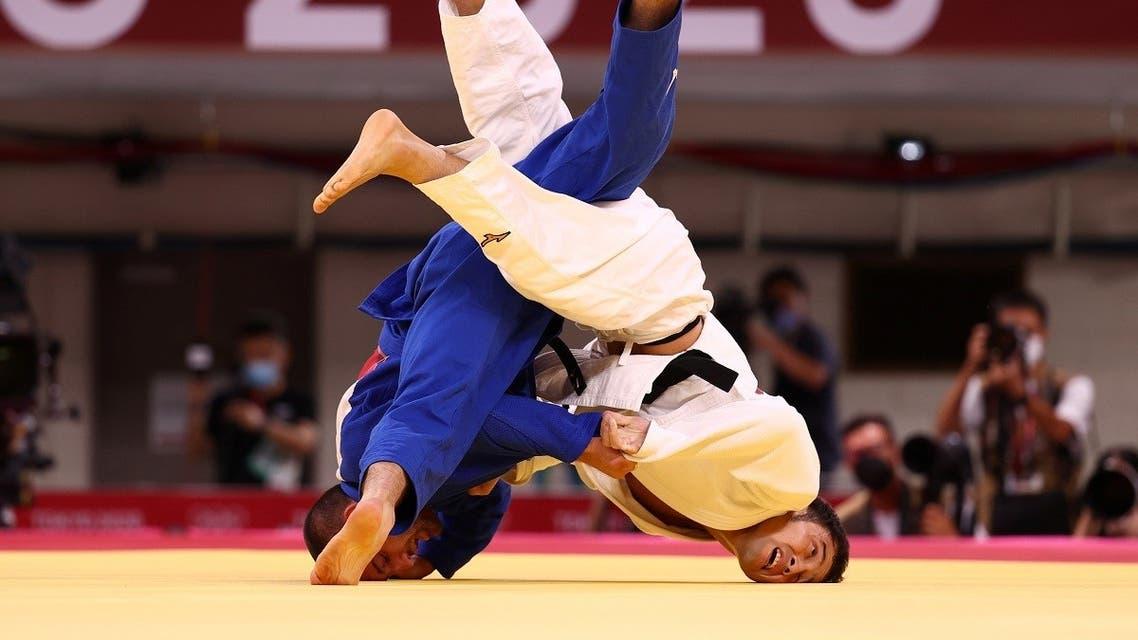 Lukhumi Chkhvimiani of Georgia in action against Naohisa Takato of Japan during the Judo Men's 60 kg quarterfinal at Nippon Budokan, Japan, July 24, 2021. (Reuters/Sergio Perez)