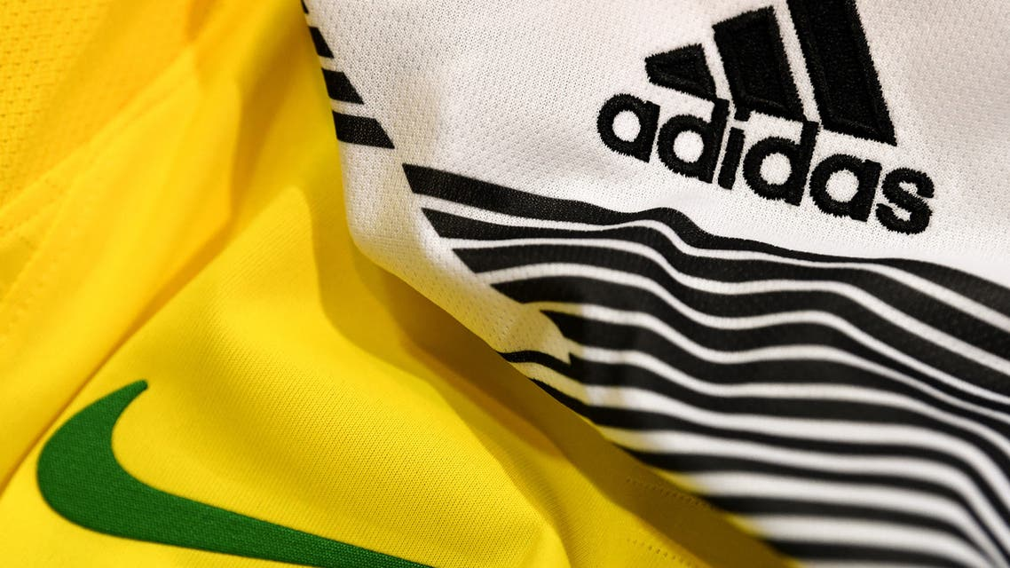 A picture taken on April 25, 2018 in Paris, shows the logo of sports wear manufacturers Nike and Adidas for the FIFA 2018 World Cup football tournament. (AFP)