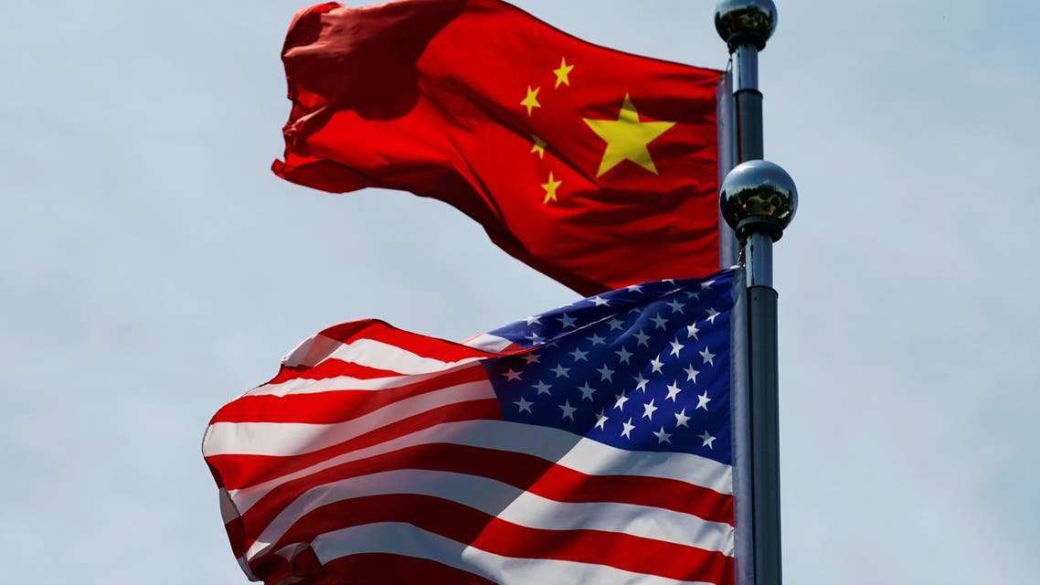 Chinese and US flags flutter near The Bund, before US trade delegation meet their Chinese counterparts for talks in Shanghai, China July 30, 2019. (Reuters)