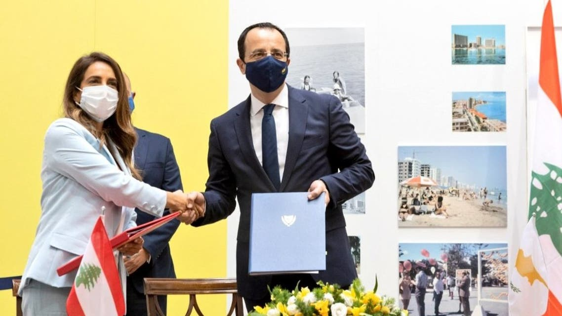 Lebanon's Deputy Prime Minister and Defense Minister Zeina Akar shakes hands with Cyprus Foreign Minister Nikos Christodoulides on  23 July, 2021 in Cyprus. (Twitter)