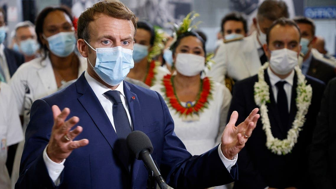 France's President Emmanuel Macron speaks to doctors and nurses working at the French Polynesia Hospital Centre in Papeete following his arrival for a visit to Tahiti in French Polynesia on July 24, 2021.  (Ludovic MARIN/AFP)