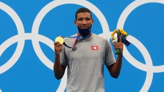 Tunisia's 18-year-old Hafnaoui wins gold at Tokyo Olympics' 400m freestyle swim