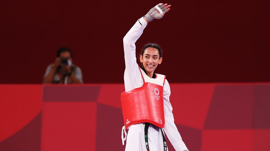 Tokyo 2020 Olympics - Taekwondo - Women's Featherweight 49-57kg - Quarterfinal - Makuhari Messe Hall A, Chiba, Japan - July 25, 2021. Kimia Alizadeh of the Refugee Olympic Team celebrates after competing REUTERS/Murad Sezer