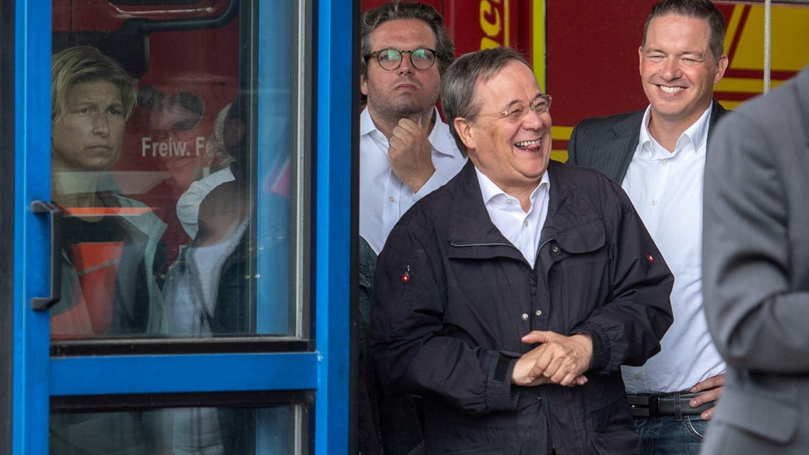 FILE PHOTO: CDU leader and North Rhine-Westphalia's State Premier Armin Laschet laughs as the German president (unseen) delivers a speech during their visit to flood-hit Erftstadt, Germany July 17, 2021. Picture taken July 17, 2021 Marius Becker/Pool/File Photo