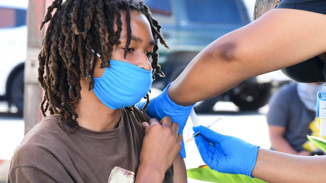 Jacob Alexander, 14, receives her Pfizer Covid-19 vaccine from vocational nurse Eon Walker at a mobile vaccine clinic hosted by Mothers in Action and operated by the Los Angeles County of Public Health on July 16, 2021 in Los Angeles, California. Covid-19 cases across America are rising in all 50 states as the Delta variant spreads with half the US population yet to be fully vaccinated.