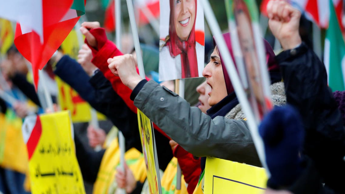 People attend a protest organised by National Council of Resistance of Iran in Germany to support nationwide demonstrations in Iran against the rise in gasoline prices, in Berlin, Germany November 17, 2019. (Reuters)