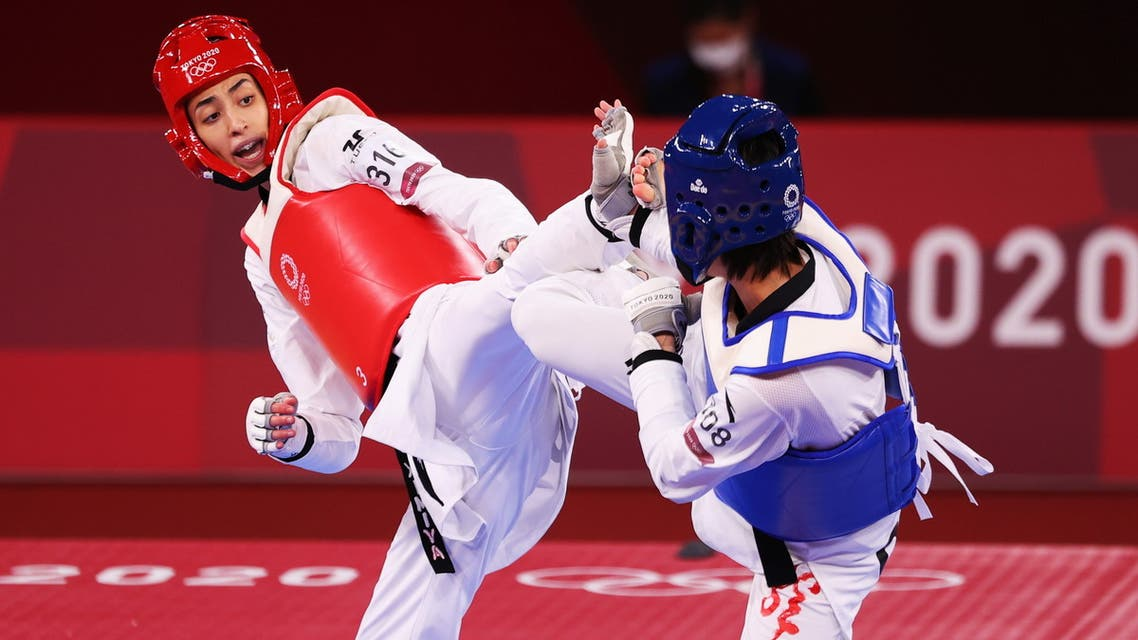 Kimia Alizadeh of the Refugee Olympic Team in action against Zhou Lijun of China. (Reuters)