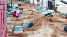 Torrent of floodwater in Belgium washes away cars
