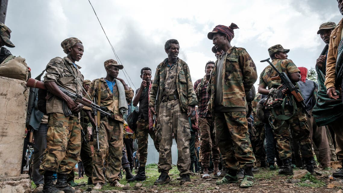 Members of the Amhara militia gather in the village of Adi Arkay, 180 kilometers northeast from the city of Gondar, Ethiopia, on July 14, 2021. On Wednesday the Amhara government spokesman Gizachew Muluneh announced that regional special forces and militias would shift to attack mode to reverse the recent battlefield gains by the Tigrayan rebels.