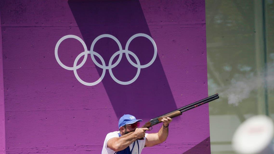 Jul 25, 2021; Tokyo, Japan; Nikolaos Mavrommatis (GRE) shoots during the men's skeet qualifying round at the Tokyo 2020 Olympic Summer Games at Asaka Shooting Range. (Reuters)