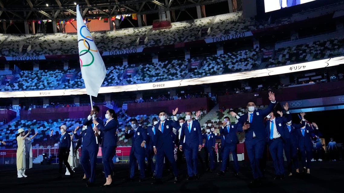 The Refugee Olympic Team enters the stadium during the opening ceremony for the Tokyo 2020 Olympic Summer Games on July 23 2021. (USA Today/Reuters)