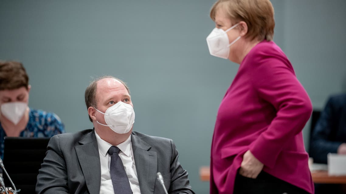 German Chancellor Angela Merkel wears a protective face mask as she talks to Chancellery's Chief of Staff Helge Braun before the weekly cabinet meeting of the German government at the chancellery in Berlin, Germany, March 3, 2021. (Reuters)