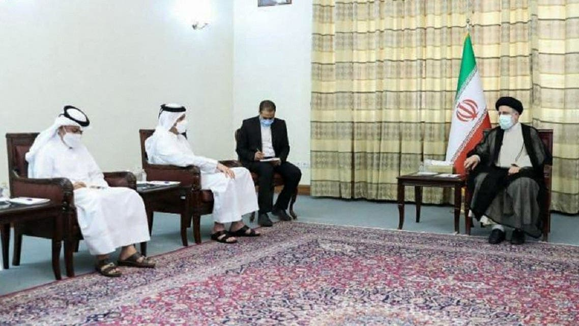 A handout picture provided by the office of Iran's President-elect Ebrahim Raisi shows him (R) meeting with Qatari FM Sheikh Mohammed Bin Abdulrahman Al-Thani (2nd-L) at his office in Tehran, July 25, 2021. (AFP)