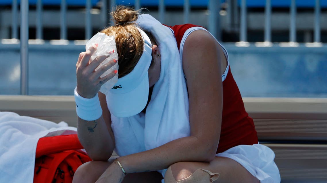 Anastasia Pavlyuchenkova of the Russian Olympic Committee holds an ice pack to her head during a changeover against Sara Errani of Italy (not pictured) in a women's singles first round match during the Tokyo 2020 Olympic Summer Games at Ariake Tennis Park. (Reuters)