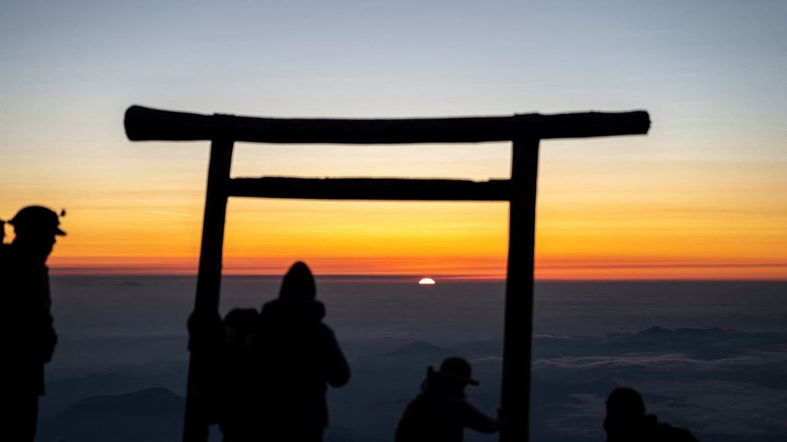 This photo taken on July 19, 2021 shows people watching the sunrise from the summit of Mount Fuji, some 70 kilometres (43 miles) west of the capital Tokyo. (AFP)