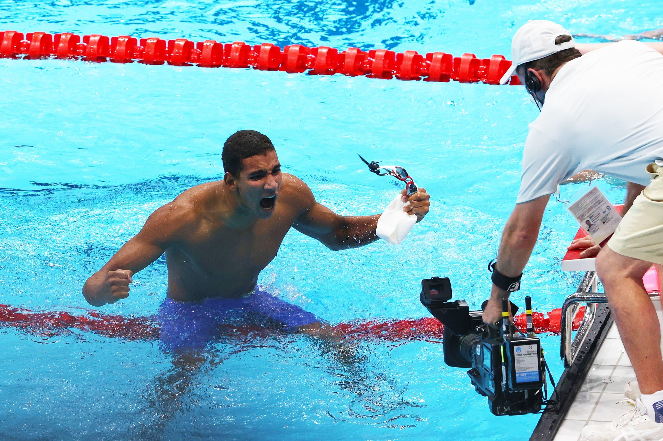 Ahmed Hafnaoui of Tunisia celebrates after winning. (Reuters)