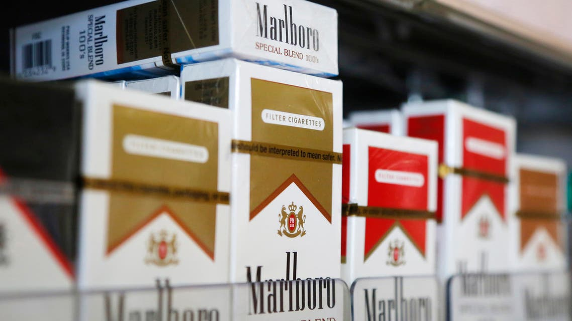 Packs of Marlboro cigarettes are displayed for sale at a convenience store in Somerville, Massachusetts July 17, 2014. Cigarette maker Philip Morris International Inc cut its earnings forecast for 2014 and said it is proving to be a complex and truly atypical year for the company. (Reuters)